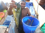 Cholai shows off a catch of Dolphin fish for dinner. Pix by Manuai