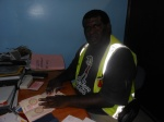 Mr. John Kiu, Custom officer in Buka preparing outward clearance before Climate Challenger disembarks for Solomon Islands.