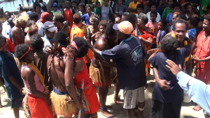 Pere villagers happy to see the Climate Challenger crew return home safely. (photo: still taken from video)